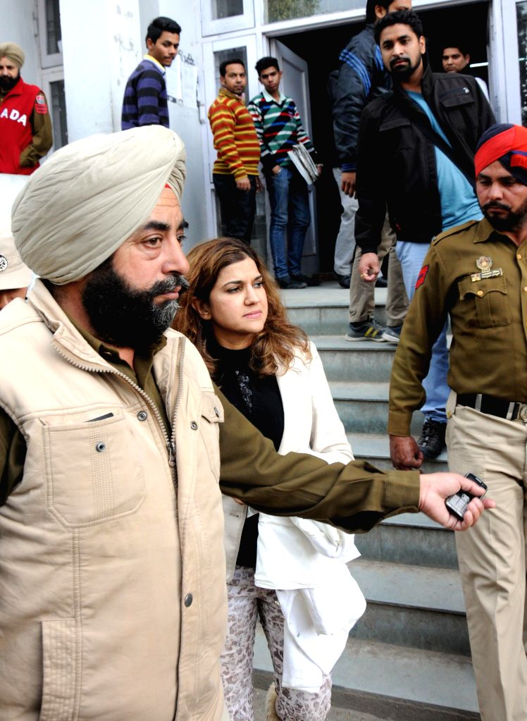 Manjita Dhillon, a US citizen of Indian origin, who was Wednesday (24th Feb 2015) detained at the Amritsar International Airport with 25 live bullets when she was trying to board a flight ...