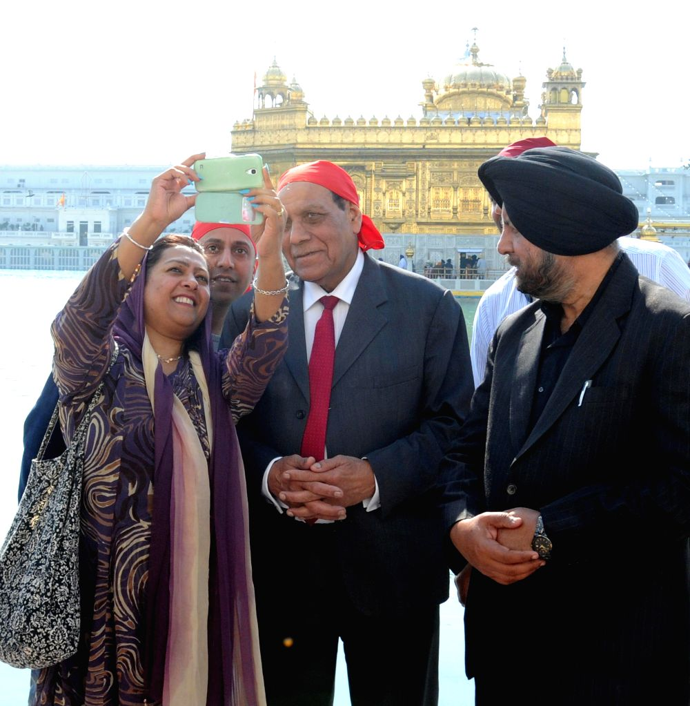 Amritsar : Mayor of Ealing, Councillor Tej Ram Bagha paying obeisance at Golden Temple in Amritsar on Jan. 31, 2015.