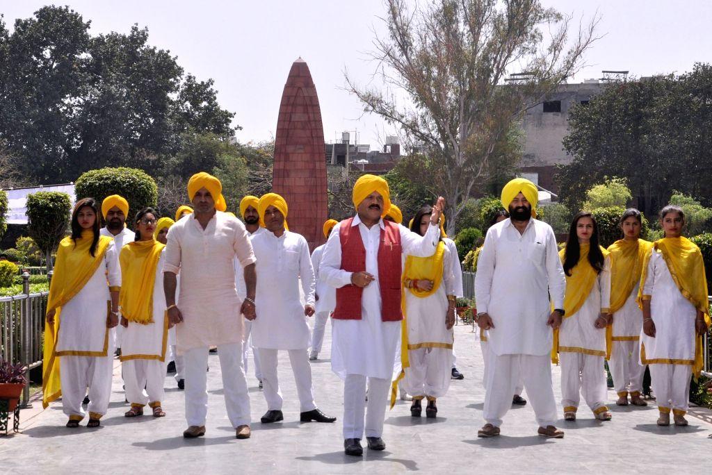 Amritsar MLA and Punjab Warehousing Corporation Chairman Raj Kumar Verka along with other artistes perform during a song shoot ahead of the 100th anniversary of the Jallianwala Bagh ... - Kumar Verka