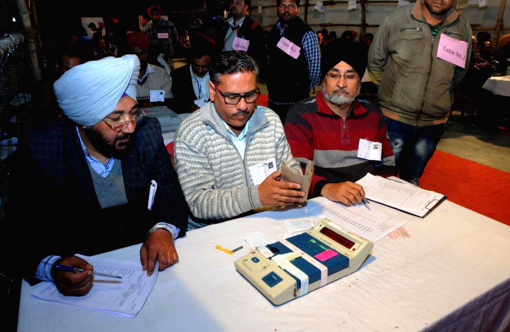 :Amritsar: Officials prepare Electronic Voting Machines as the counting begins for the Punjab assembly election in Amritsar on March 11, 2017. (Photo: IANS).