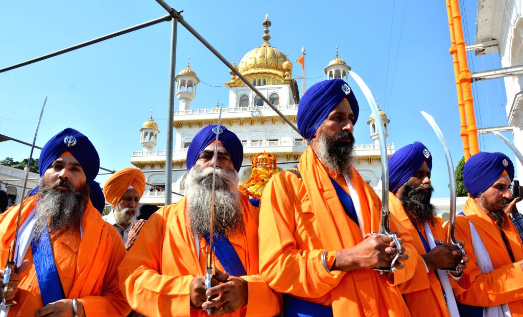 Panj Pyare's lead a religious procession organised at Golden Temple on the eve of Guru Nanak Dev's birthday, in Amritsar, on Nov 5, 2014. - Nanak Dev