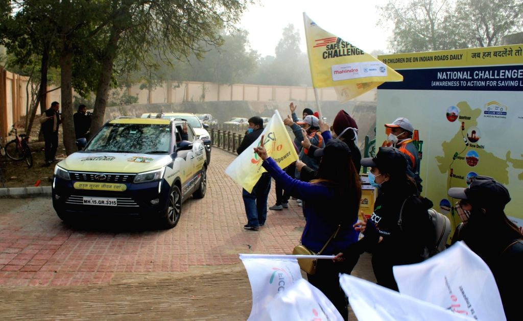 Amritsar:  Participants gesture while driving their cars from Amritsar to Kanyakumari during the 'India Against Road Crash' awareness campaign, in Amritsar on January 18, 2021.