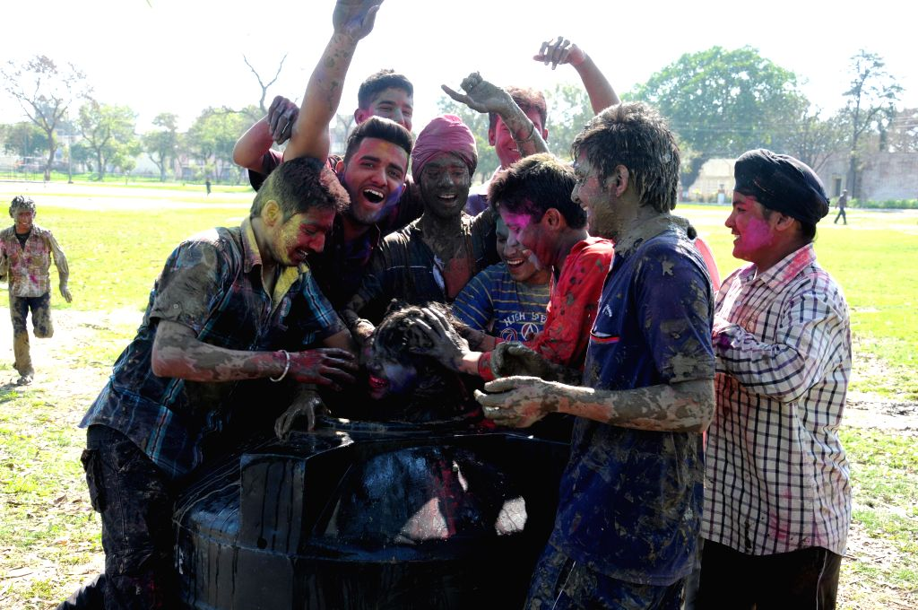 People celebrate holi in Amritsar on March 6, 2015.
