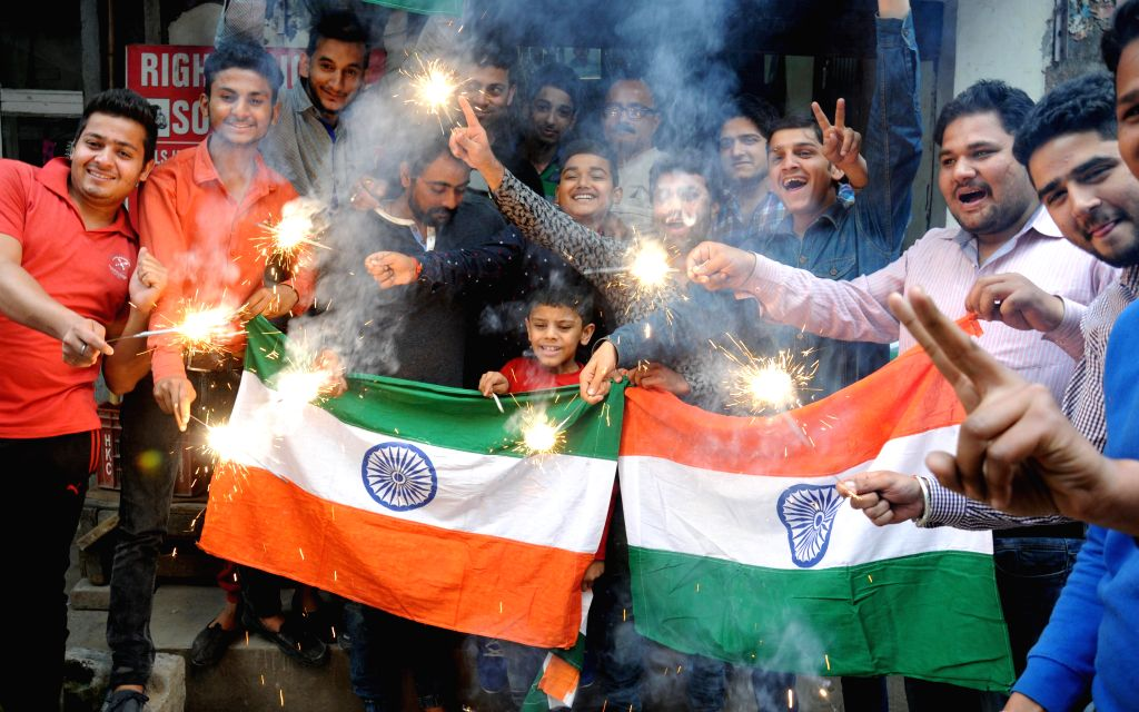 People celebrate India's victory over Bangladesh in the ICC World Cup - 2015 semi finals in Amritsar on March 19, 2015.