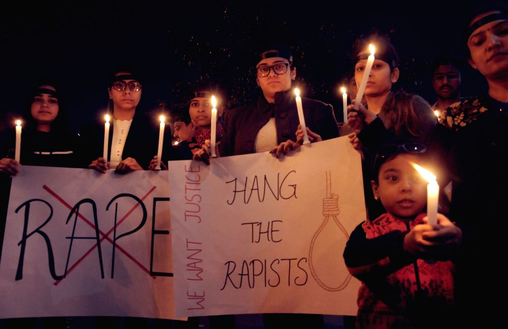 Amritsar: People participate in a candlelight vigil to express solidarity with the veterinarian who was gang raped and murdered in Hyderabad; demanding death penalty for the culprits, in Amritsar on Dec 4, 2019. (Photo: IANS)