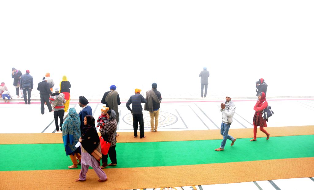 People pay obeisance at the Golden Temple in Amritsar, on Dec 17, 2014.
