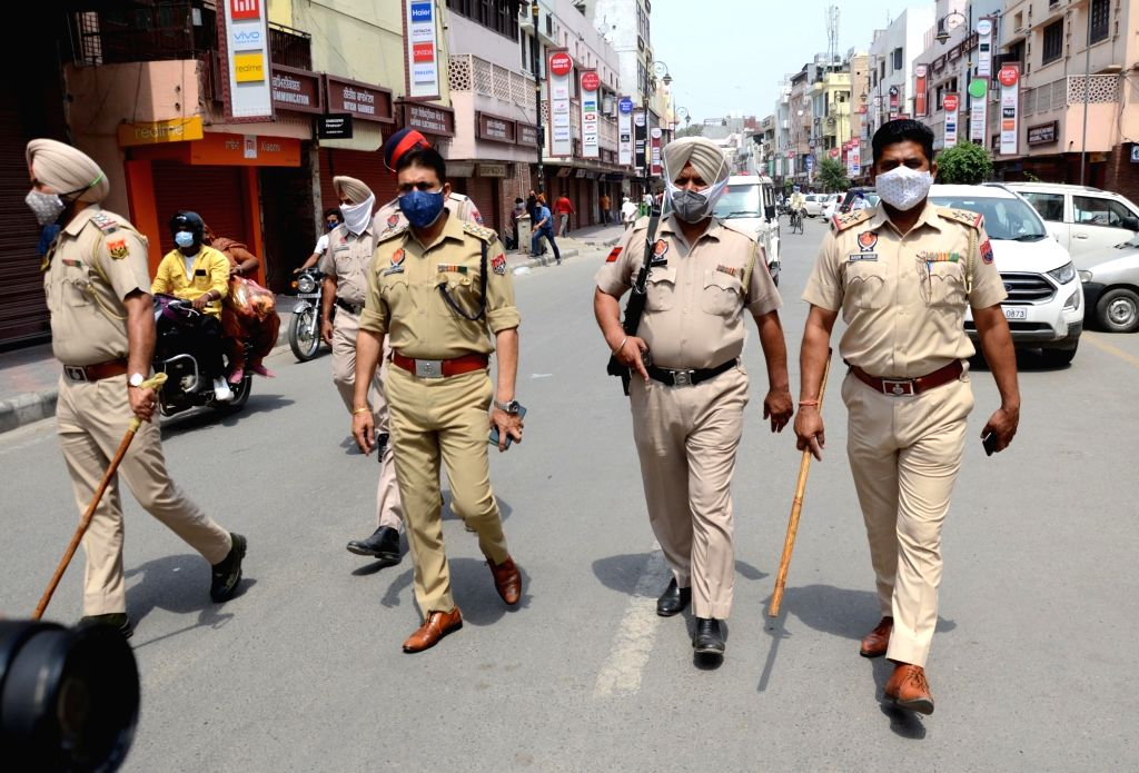Amritsar: Police personnel patrol on the street  during the new restrictions of Lockdown till 15 may are announced by the state government, in Amritsar on Monday, May 03,2021.(Photo:Pawan sharma/IANS)
