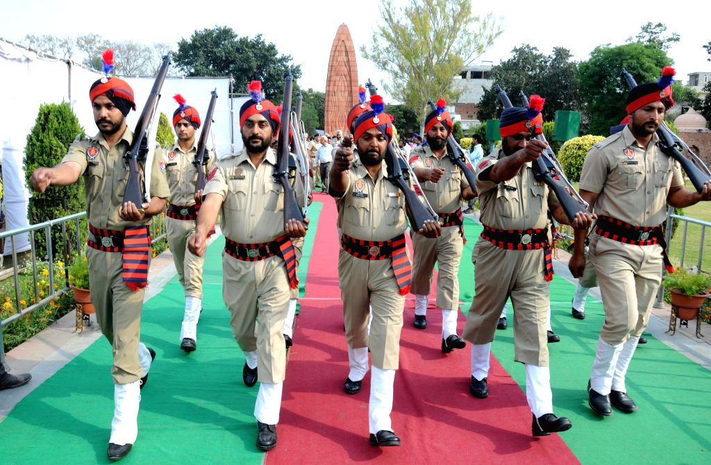 Policemen pay tribute to martyrs during a programme organised on the anniversary of Jallianwala Bagh massacre in Amritsar, on April 13, 2015.