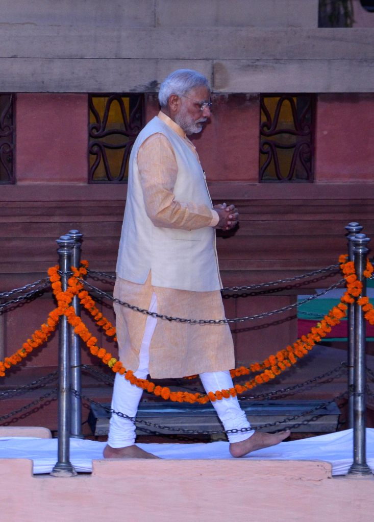 Prime Minister Narendra Modi pays tribute at Jallianwala Bagh in Amritsar, on March 23, 2015. - Narendra Modi