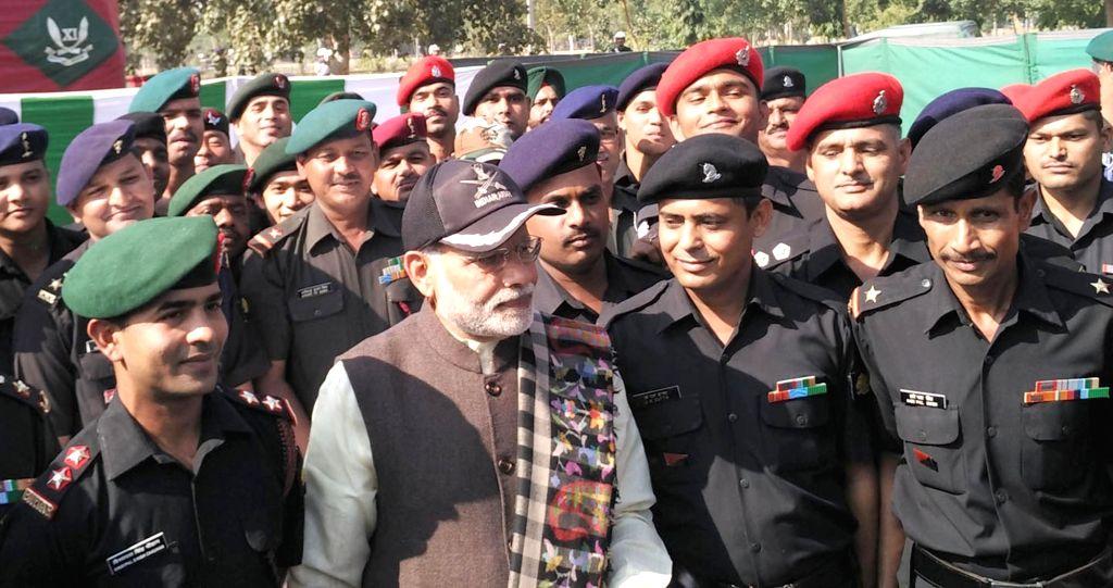 :Amritsar: Prime Minister Narendra Modi with the soldiers at the Dograi War Memorial, in Khasa, Amritsar, Punjab on Nov 11, 2015. (Photo: IANS). - Narendra Modi