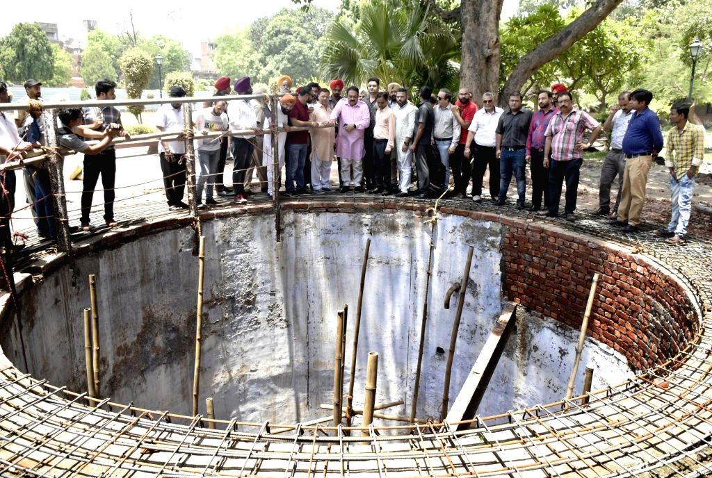 Amritsar: Punjab BJP President and Trustee of Jallianwalla Bagh National Memorial Trust Shwet Malik accompanied by party workers, visits the century-old Martyrs' Well which is currently undergoing renovation, at the Jallianwala Bagh in Amritsar on Ju - Malik
