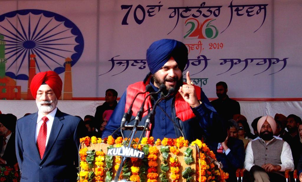 Amritsar: Punjab Cabinet Minister Navjot Singh Sidhu hoists the national flag on Republic Day in Amritsar, on Jan 26, 2019. - Navjot Singh Sidhu
