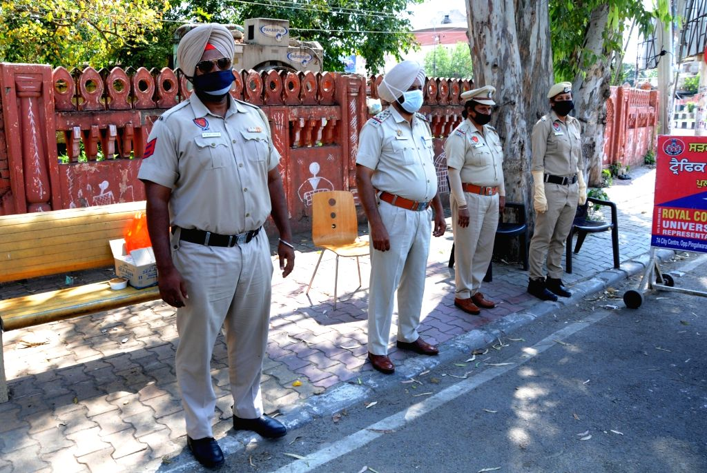Amritsar: Punjab police personnel wear the name of ASI Harjeet Singh on their badges, whose hand was chopped off in clashes between the police and the Nihang Sikhs in Patiala; as a gesture to honour him in Amritsar during the extended nationwide lock - Harjeet Singh