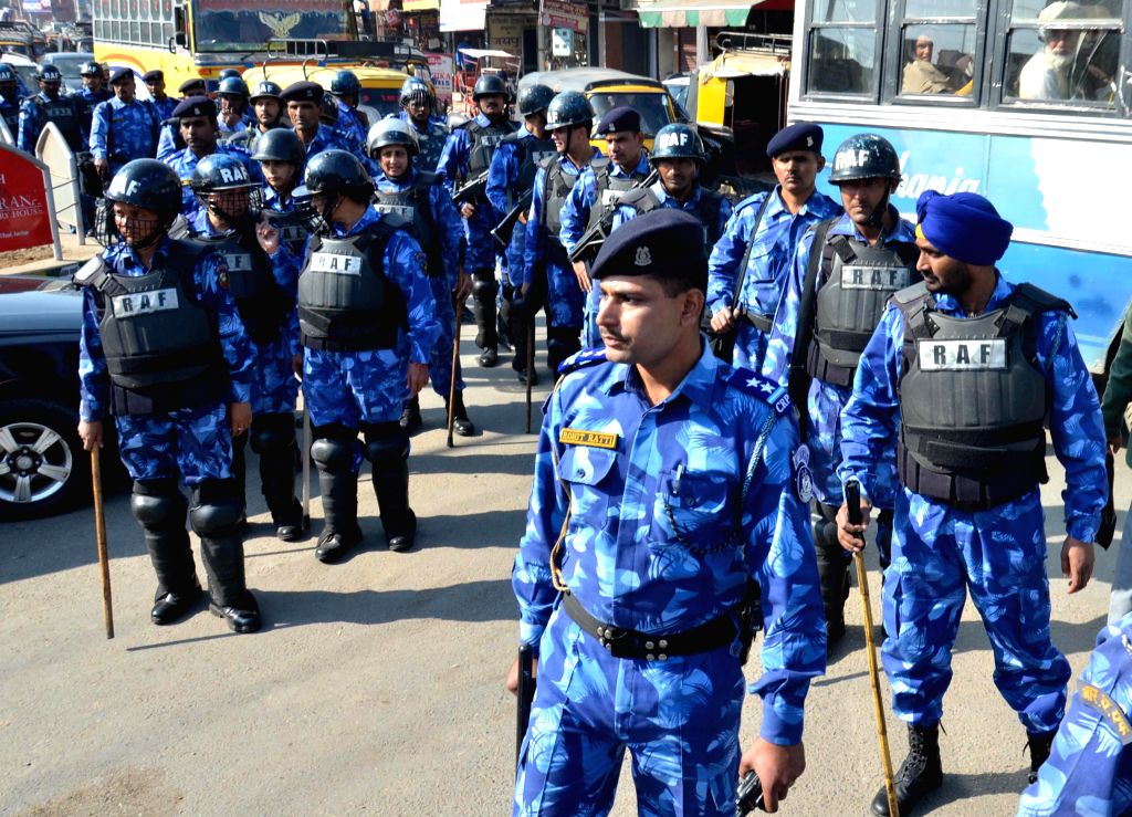 Rapid Action Force conducts a flag march in Amritsar ahead of the release of Dera Saccha Sauda chief Gurmeet Ram Rahim Singh starrer `MSG - The Messenger of God` on Jan 16, 2015.