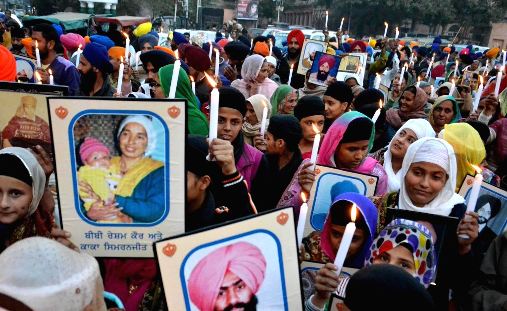 Sikh activists participate in a candlelight vigil on Human Rights Day in Amritsar, on Dec 10, 2014.