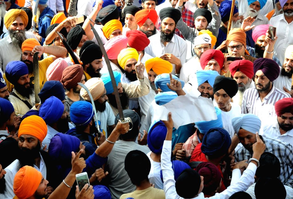 Amritsar: Sikh activists participate in a 'genocide remembrance march' organised by the Shiromani Gurdwara Parbandhak Committee on the 35th anniversary of Operation Bluestar, at the Golden Temple in Amritsar on June 6, 2019. (Photo: IANS)