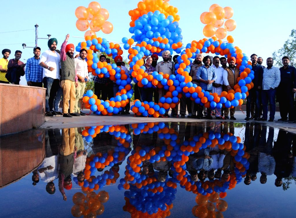 Amritsar: Sikh devotees release balloons as celebrations commence ahead of 55oth birth anniversary of Guru Nanak Dev, in Amritsar on Nov 8, 2019. (Photo: IANS) - Nanak Dev