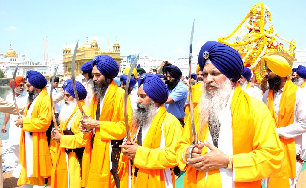 Sikhs participate in a religious procession organised on the eve of Guru Teg Bahadur's birth anniversary at the Golden Temple in Amritsar, on April 8, 2015.