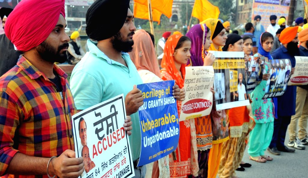 Amritsar: Sikhs stage a demonstration to demand justice for the victims of 1984 anti-sikh riots in Amritsar, on Nov 2, 2015. (Photo: IANS)