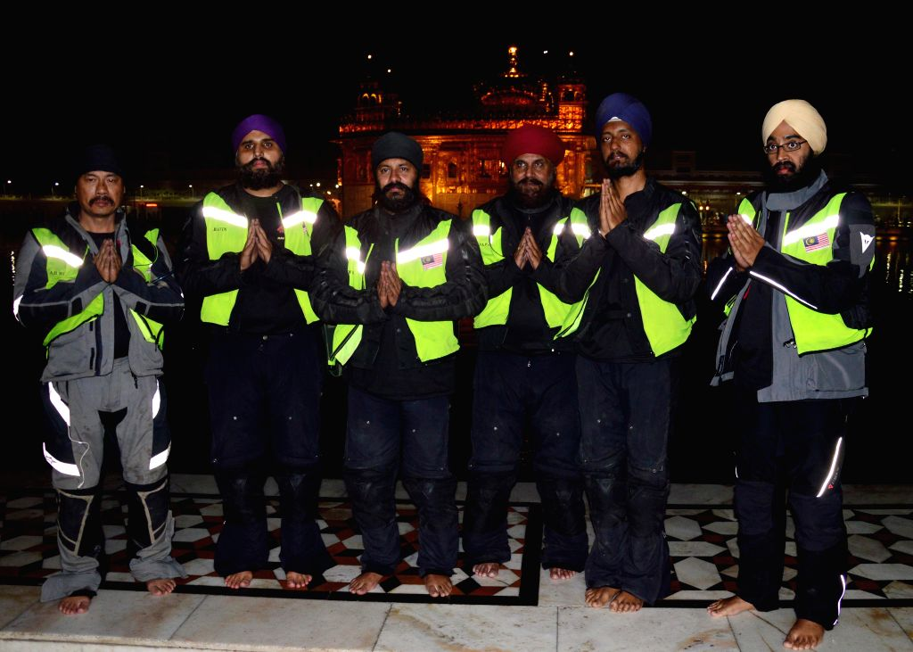 Six Sikh Malaysian bikers on their motorbikes reached at Golden Temple after traveling 6100 kilometers passing through vast swathes of Malaysia, Thailand, Burma and India in Amritsar on ...