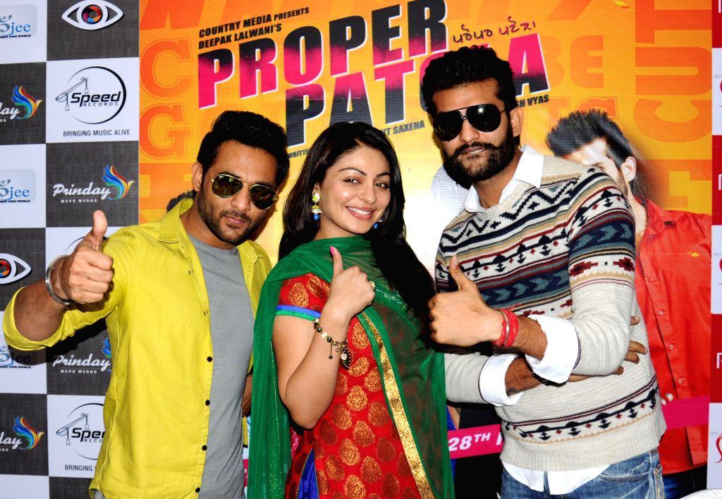 Starscast of upcoming Punjabi movie `Proper Patola` Neeru Bajwa, Yuvraj Hans and Harish Verma during a press confrence in Amritsar, on Nov 26, 2014. - Harish Verma