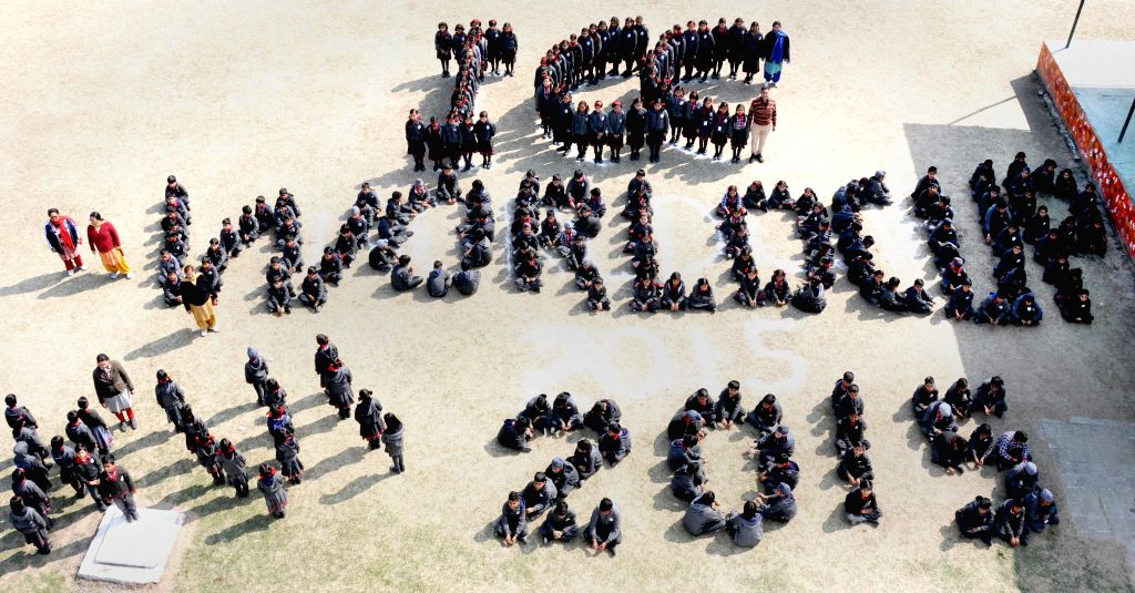 Students stand in the formation of `ICC World CUP 2015` in Amritsar on Feb 12, 2015.