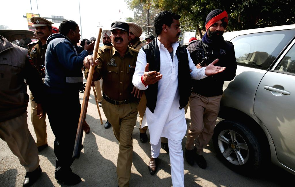 The activists of Shiv Sena being arrested by Punjab Police officials after a clash erupted  between Shiv Sena and Damdami Taksaal during a protest in Amritsar on Feb 12, 2015.