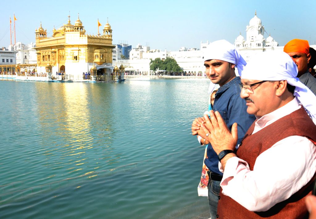 Union Health and Family Welfare Minister JP Nadda talks to press after visiting the Golden Temple in Amritsar, on Nov 17, 2014.