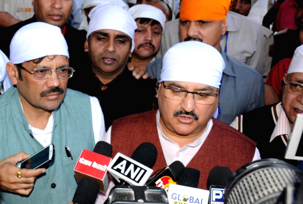 Union Health and Family Welfare Minister JP Nadda pays obeisance at the Golden Temple in Amritsar, on Nov 17, 2014.