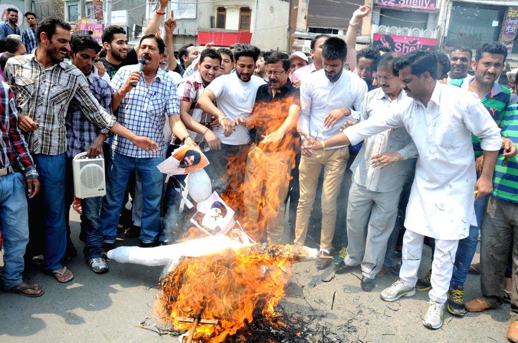 Various hindu organisations burn an effigy of Shiromani Akali Dal (SAD) leaders blaming them for supporting terrorist in Amritsar on April 14, 2015.