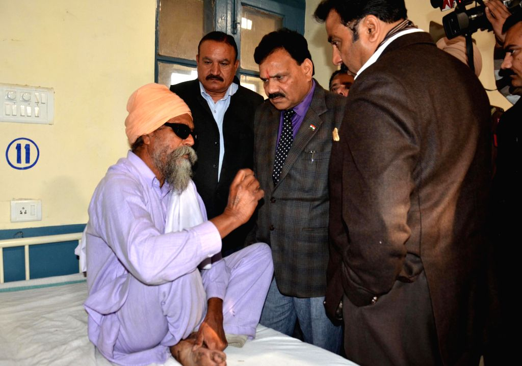 Vice Chairman of National Commission for Scheduled Castes Raj Kumar Verka meets a patient who lost his vision after undergoing an eye surgery at an eyecamp organised by an NGO in Gurdaspur .