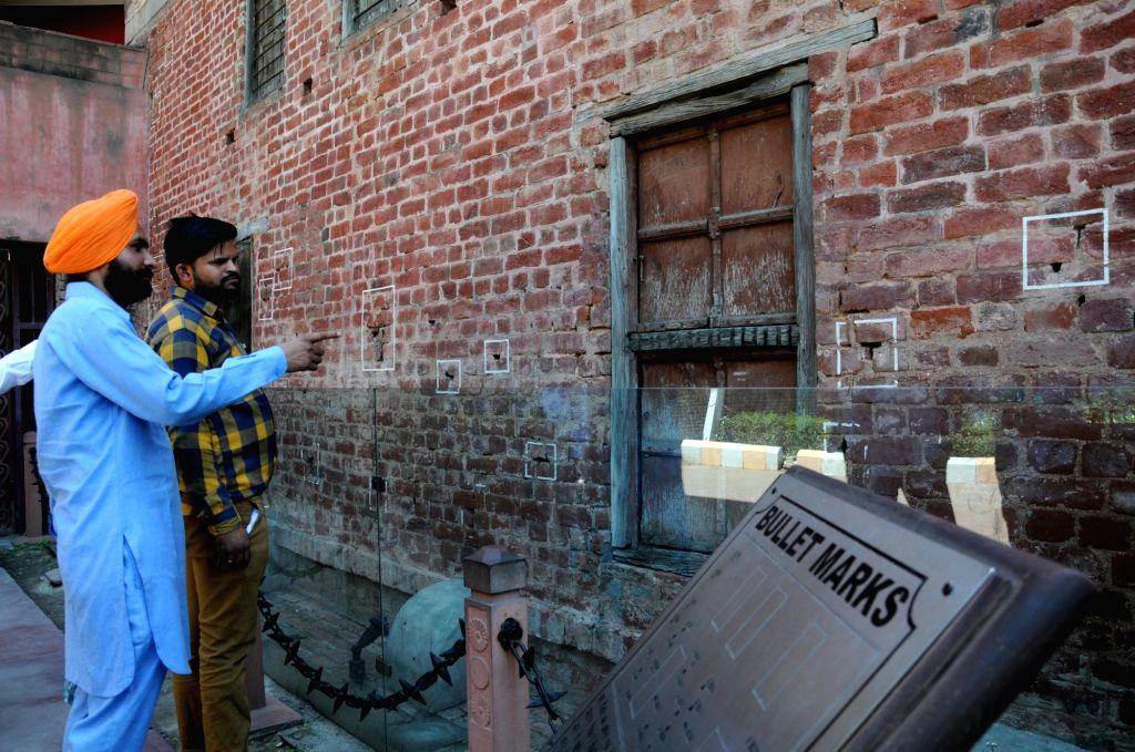Amritsar: Visitors visit the Jaillanawala Bagh on the 99th anniversary of the Jallianwala Bagh massacre, in Amritsar on April 13, 2018. (Photo: IANS)