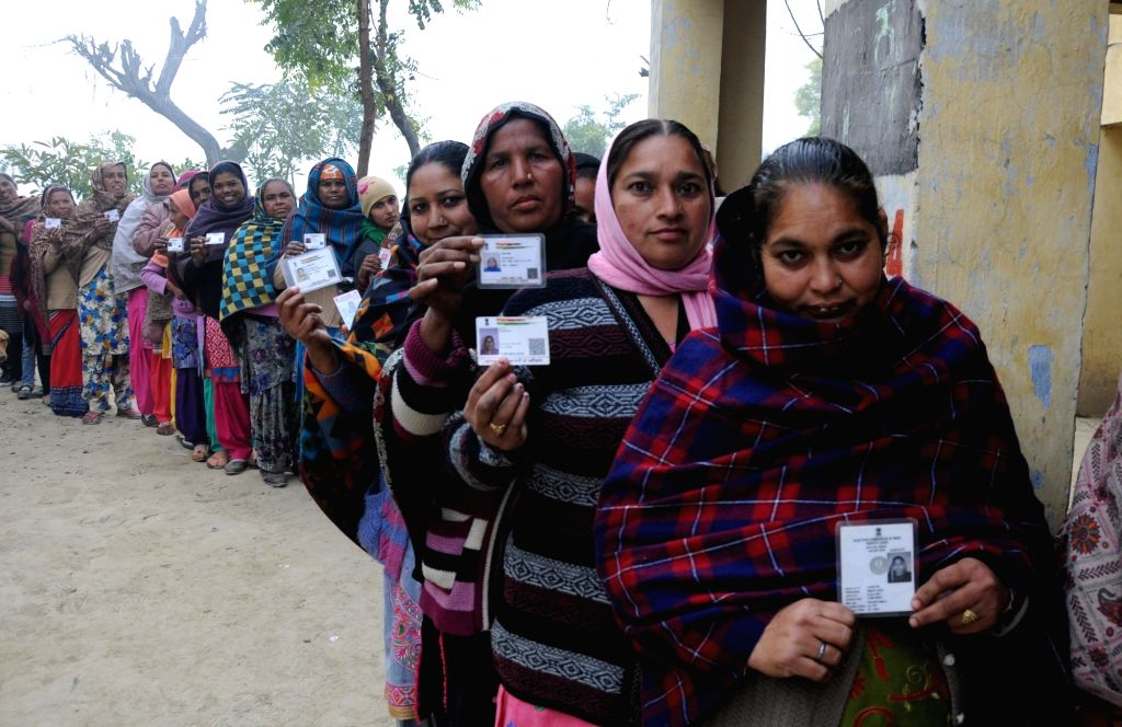 Amritsar: Women wait in a queue to cast their votes for Punjab panchayat elections, at a polling booth in Amritsar on Dec 30, 2018. (Photo: IANS)