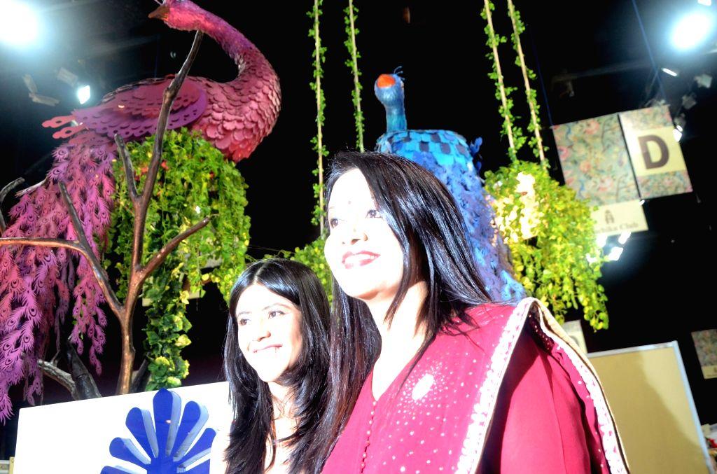 Amruta Fadnavis, singer-Banker and wife of Maharashtra Chief Minister Devendra Fadnavis and producer Ekta Kapoor visit Ruchita Fest 2017 in Mumbai on July 6, 2017. - Devendra Fadnavis and Ekta Kapoor