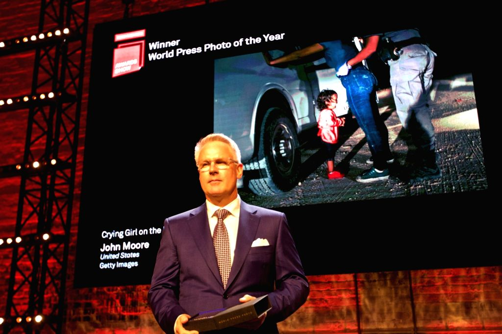 """AMSTERDAM, April 12, 2019 - Winner of World Press Photo of the Year, John Moore is seen with his image """"Crying Girl on the Border"""" at the awarding ceremony in Amsterdam, the Netherlands, ..."""