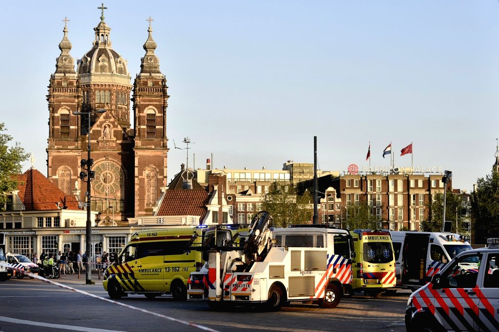 AMSTERDAM, June 10, 2017 - Rescue vehicles stand by at the site of a car crash in Amsterdam, the Netherlands, on June 10, 2017. In front of Amsterdam Central Station a car hit pedestrians and crashed ...