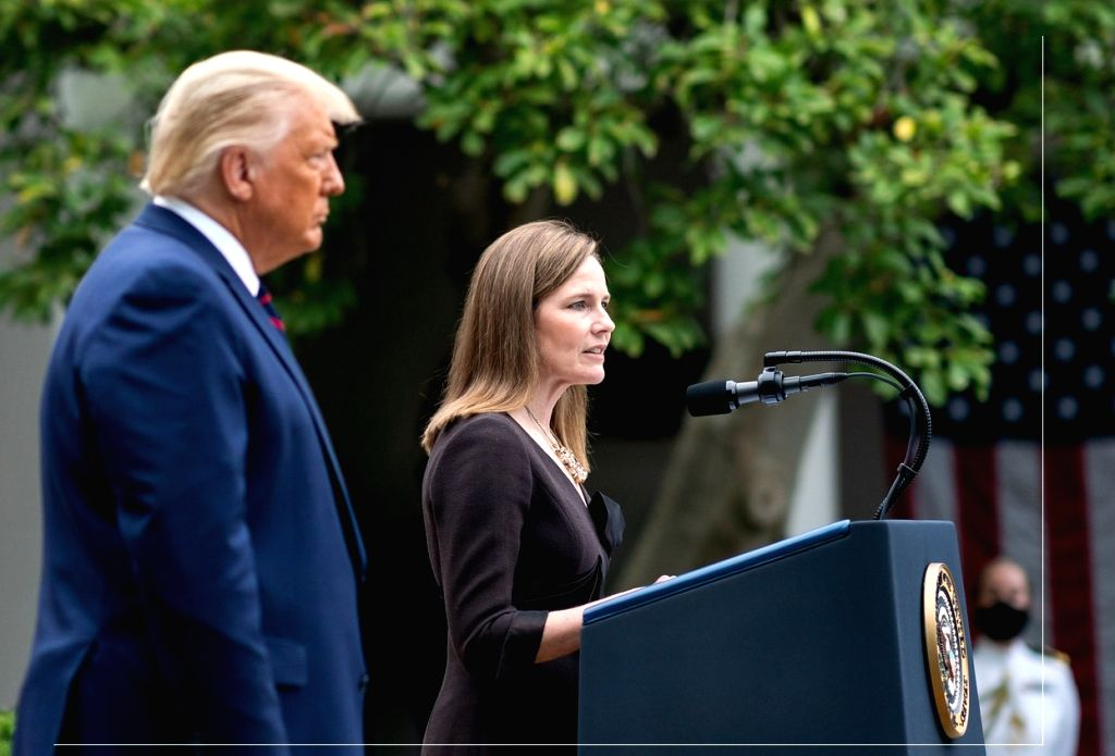 Amy Coney Barrett speaks at the White House after United States President Donald Trump, left, nominated her to the Supreme Court on September 26, 2020. She was confirmed by the Senate on October 26, 2020. (Photo: White House/IANS)