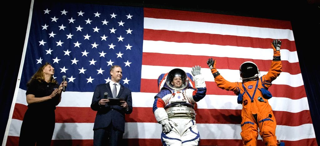 Amy Ross, a spacesuit engineer at NASA???s Johnson Space Center, left, and NASA Administrator Jim Bridenstine, second from left, watch as Kristine Davis, a spacesuit engineer at NASA???s Johnson ...