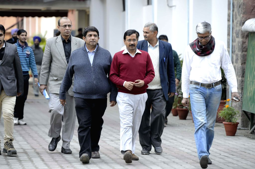 An Aam Aadmi Party (AAP) delegation led by party leaders Arvind Kejriwal and Ashutosh come out after meeting election commissioner in New Delhi, on Feb 8, 2015. - Arvind Kejriwal