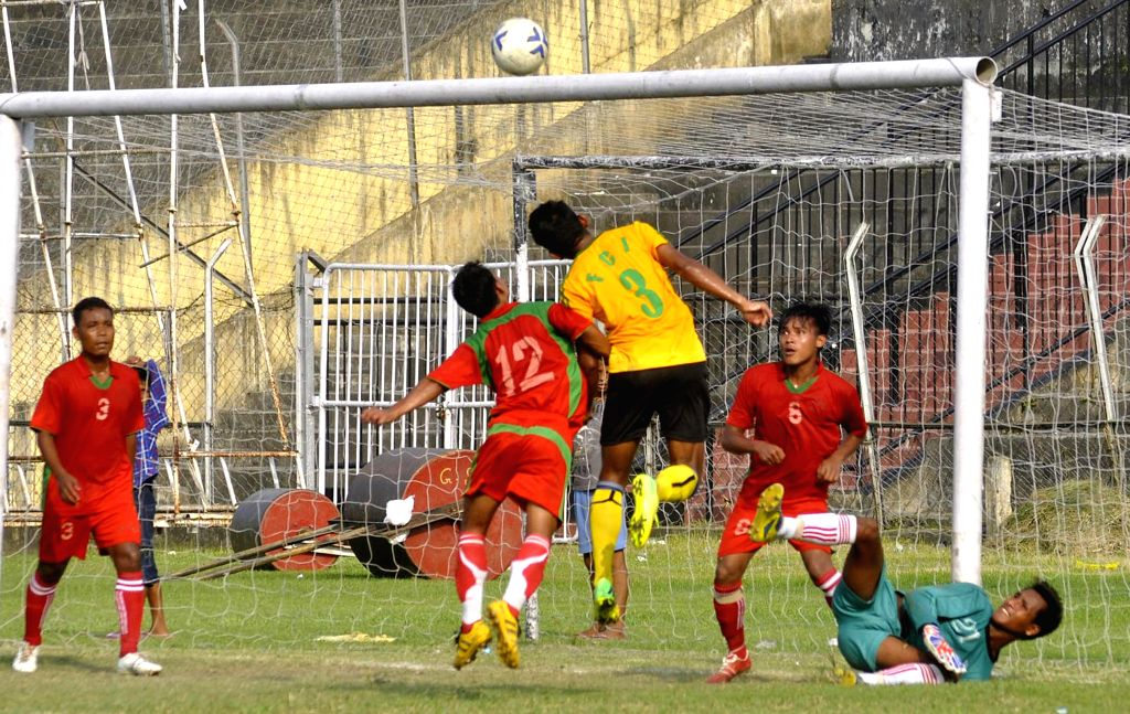 An  action moment during the 10th NN Bhattacharya Football Tournament played between Kamrupa Football club (red jersey ) and Food Corporation of India (FCI yellow jersey) organised by Guwahati Sports