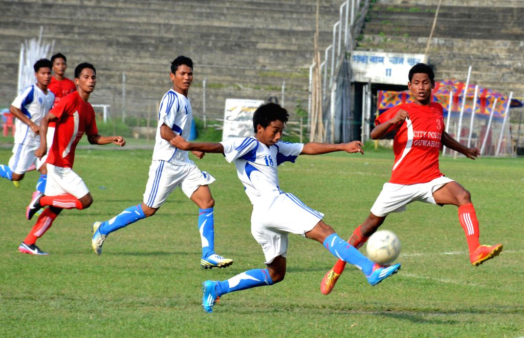 An  action moment during the 10th NN Bhattacharya Football Tournament played between City Police Guwahati (red jersey ) and Dynamo FC  organised by Guwahati Sports Association, at Nehru Stadium in ...