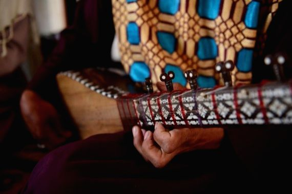 An addict plays the dambora, an Afghan traditional music instrument, at Jaghara Treatment Center in Injil district of Herat province, western Afghanistan, April 15, 2021.