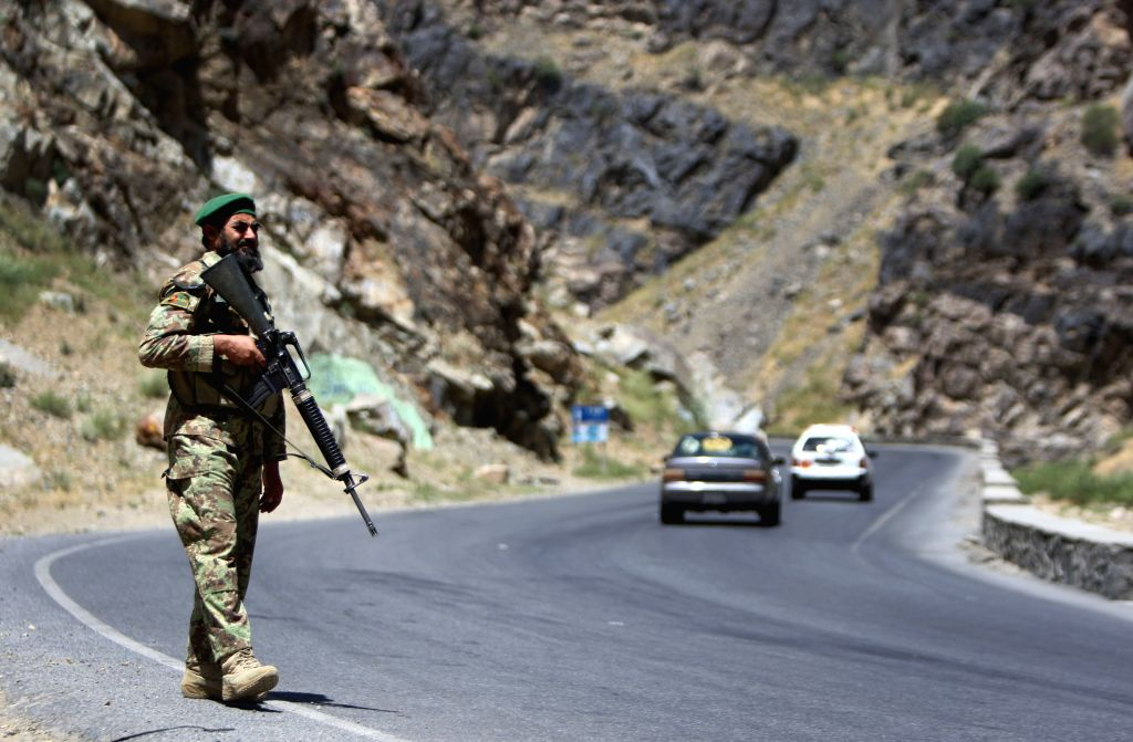 An Afghan national army soldier stands guard at a army checkpoint on the outskirts of Kabul, Afghanistan, Aug. 17, 2015. More than 100 Taliban militants have been ...