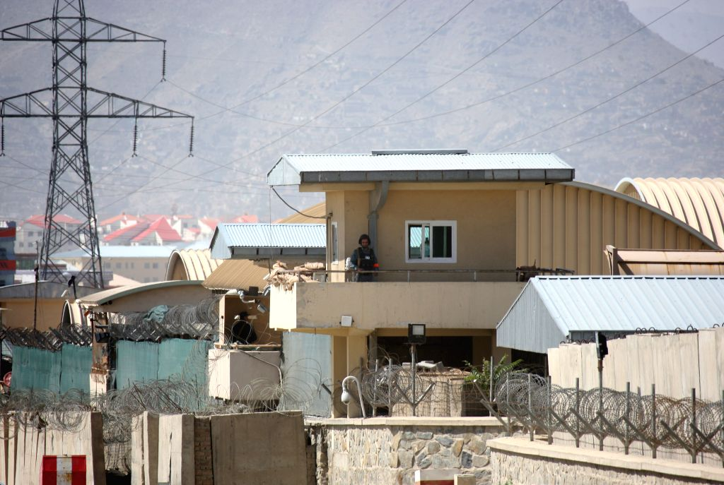 An Afghan policeman keeps watch on a guard control tower following an attack by Taliban in Kabul, Afghanistan, Aug. 8, 2015. A soldier of the NATO-led Resolute Support ...