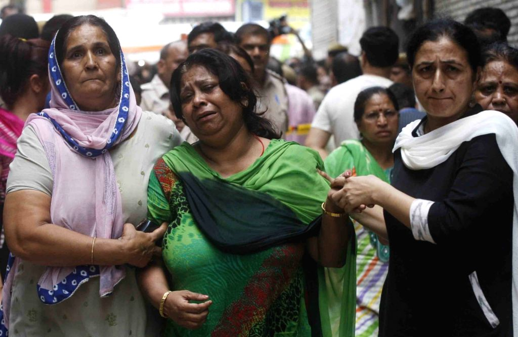An aggrieved relative of the family, 11 members of which were found deadsome blindfolded and hanging from an iron grill ceilingat their home, in New Delhi on July 1, 2018. ...