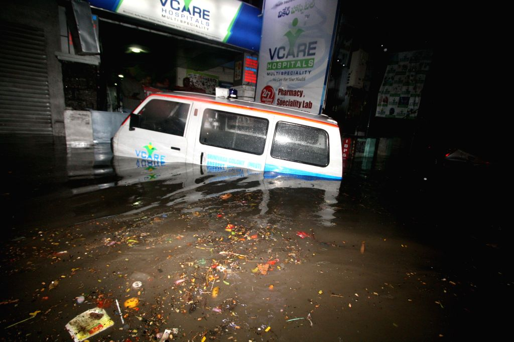 An ambulance gets submerged on a waterlogged street of Hyderabad after heavy rains in the city on July 7, 2014.