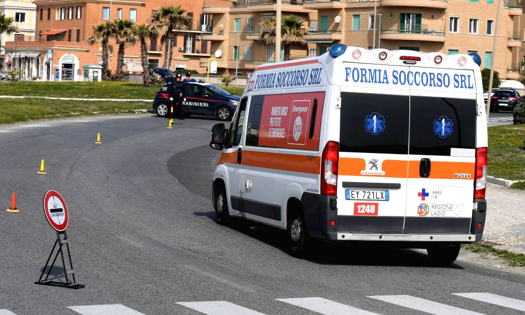 An ambulance is seen in Ostia, Rome, Italy, March 21, 2020. Italy reported 6,557 new cases of coronavirus on Saturday, raising the total to 53,578 since the pandemic ...