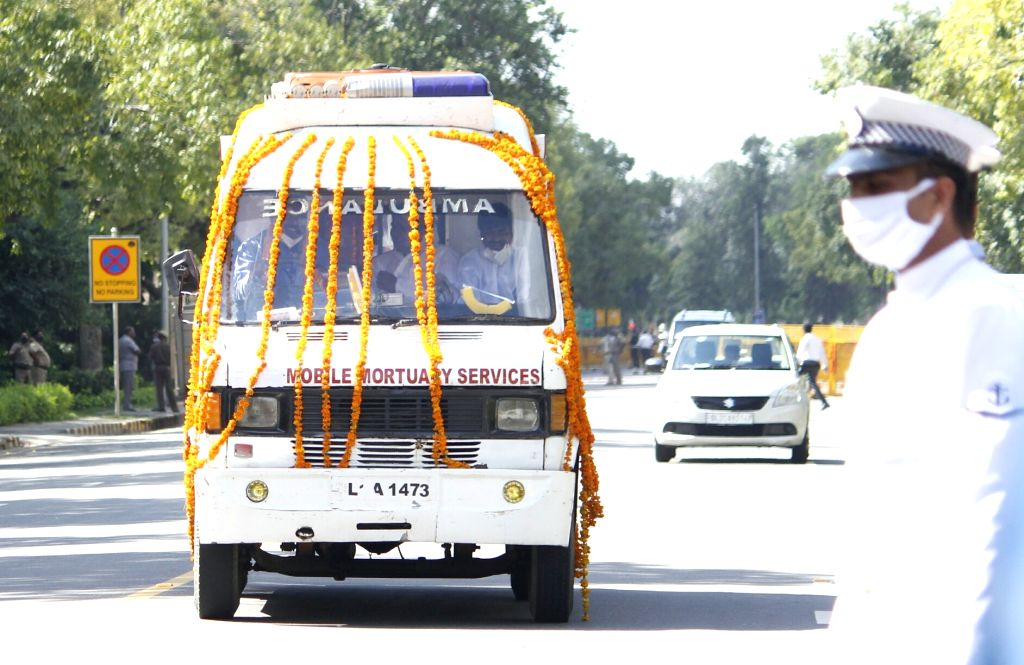 An ambulance leaves after transporting the mortal remains of Former President Pranab Mukherjee from the Army Research and Referral Hospital to his 10 Rajaji Marg residence in New Delhi on ... - Pranab Mukherjee