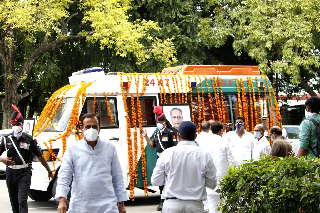 An ambulance leaves for the Lodhi Road Crematorium with the mortal remains of Former President Pranab Mukherjee from his 10 Rajaji Marg residence ahead of his funeral in New Delhi on Sep ... - Pranab Mukherjee