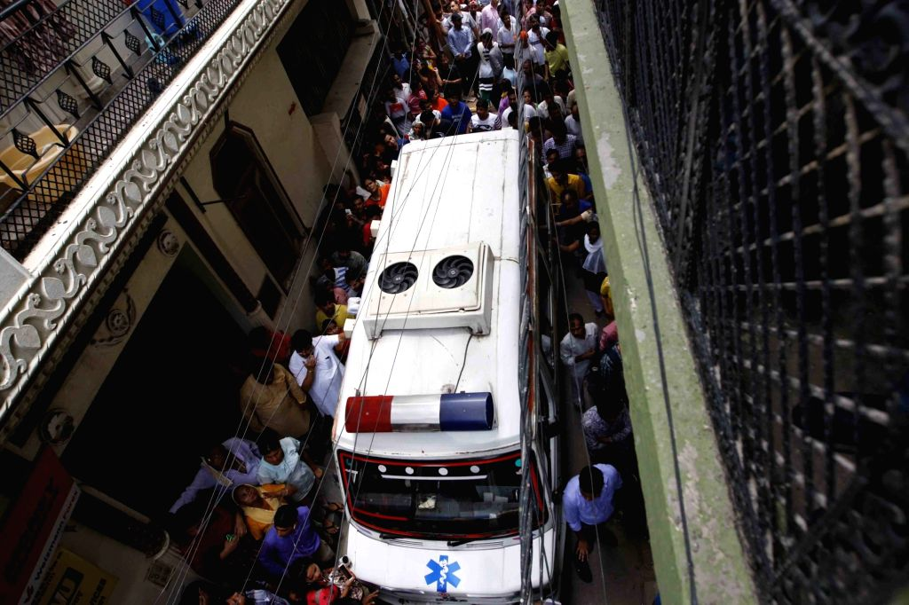 An ambulance parked at the site where 11 members of a family were found deadsome blindfolded and hanging from an iron grill ceilingat their home, in New Delhi on July 1, 2018. ...